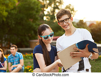 Couple of college students during a brake between classes -...
