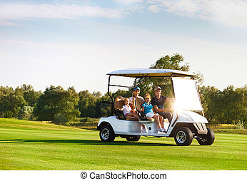 Beautiful family portrait in a cart at the golf course -...