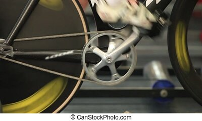 man to twist pedal stationary bike - grueling training on a...