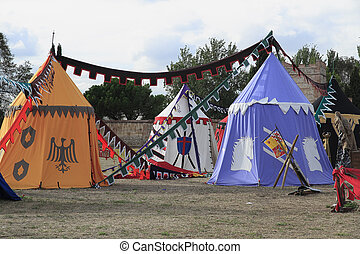 medieval military camp with several tents on Alcala de...