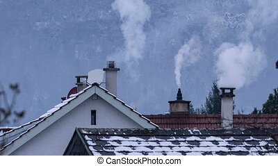 Residential chimneys with smoke - Fossil fuel heating...