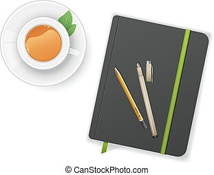 Notebook with pen and cup of tea
