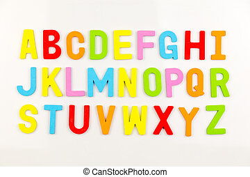 Alphabet magnets on whiteboard - Colorful alphabet magnets...