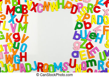 Alphabet magnets forming frame on whiteboard - Frame of...