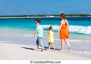 Family at Caribbean beach - Mother and kids on a Caribbean...