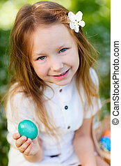 Little girl playing with Easter eggs - Adorable little girl...