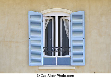 Window with louvre doors in Hermanus, Western Cape Province...