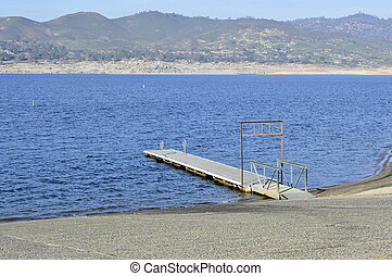 Boat dock - Boat dock on the shore of the blue lake in...