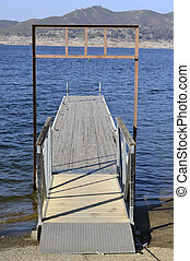 Boat dock. - Boat dock on the shore of the blue lake in...