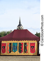 medieval military tent with a belltower at the background on...