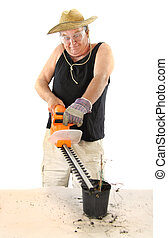 Gardener With Hedge Trimmer - Manic gardener uses a hedge...