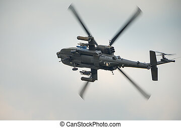 Apache attack helicopter in flight