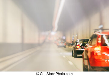 Blurred background with urban tunnel at rush hour