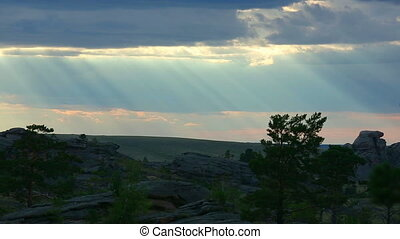Sun rays - Time-lapse scene of cloudy sky with ray of sun.