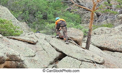 Rock climber - Climber preparing to descend the rock