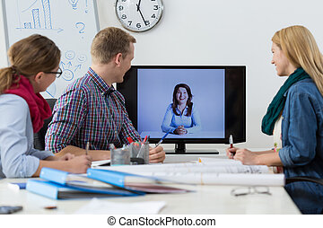 Business conference on the skype - Office workers during...