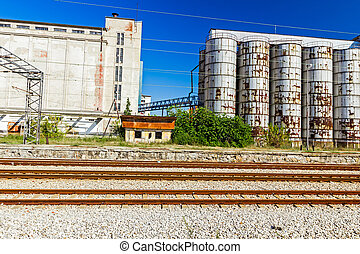 Parallel railroad tracks - Industrial Silo, in background,...