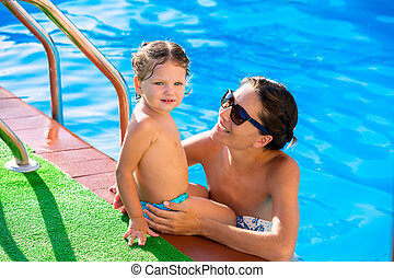 Happy mother and baby daughter swimming pool - Happy mother...