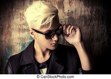 bleaching hair - Portrait of a handsome male model with...