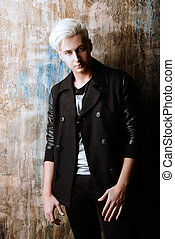 hair weave - Portrait of a beautiful male model with blond...