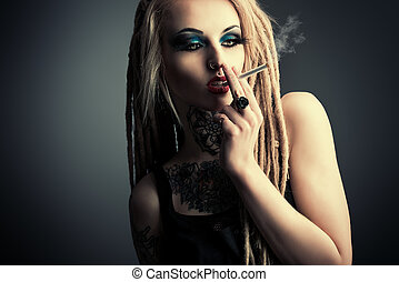 smoking girl - Sexy smoking girl with black make-up and long...