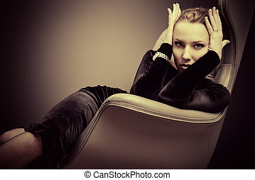 exquisite - Portrait of a stunning fashionable model sitting...