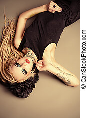 dreadlocks - Gorgeous sexy girl with black make-up and long...
