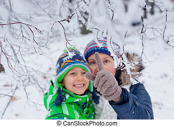 Winter boy with mother