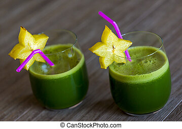 green smoothies with starfruit - two green smoothies with a...