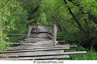 Dangerous if broken wooden bridge on foot