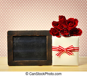 Present box with roses and blank chalkboard - Gift box with...