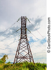 High voltage line and thunderclouds - High voltage line on a...