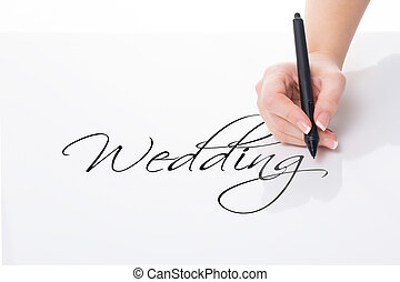 write down wedding - female hand with pen write down the...