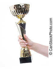 victory - female hand holding a trophy in the hand against...