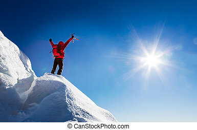 Mountaineer celebrates the conquest of the summit. Concepts:...