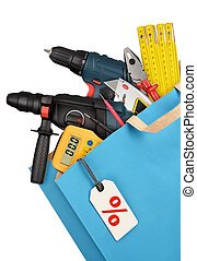 Work tools - Shopping bag with work tools isolated on white...