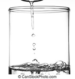 Air bubbles in water - Clear water with air bubbles in the...