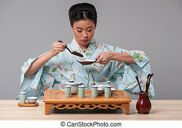 Getting ready for tea ceremony - Asian culture. Young...