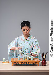 Asian beauty getting ready for tea ceremony - Asian...