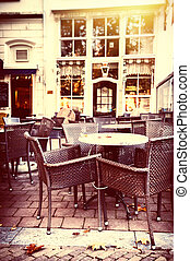 Empty street cafe terrace in autumn city at sunny day