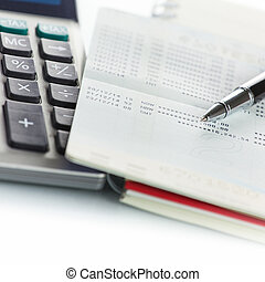Bank account - Calculator with Pen on bank account passbook