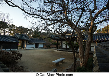 Yi Gwangno House courtyard taken during winter at sunset...