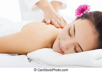 young woman in spa salon getting massage