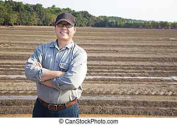 Farmer man standing on farming land