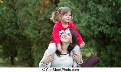 daughter with her mother in park