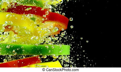 Chopped Pepper in Water - Slices of red, yellow and green...