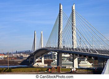 Portland Oregon new railcar and pedestrian bridge. -...