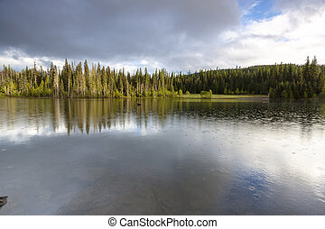 Scenic Reflections on Champion Lake in Canada's Kootenay...