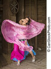 Young Woman in a Pink and Blue Dress - A young beautiful...