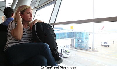 Tired woman waiting at the airport - Tired woman sleeping on...